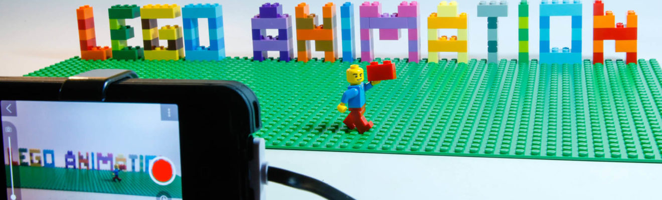 Lego figure posed in front of smart phone